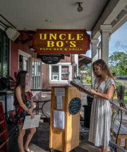 Uncle Bo's Haleiwa Host Greeting Customer
